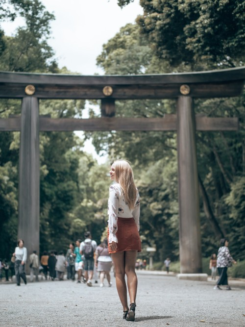 woman walking on path leading through traditional japan gate scopio 51b1b07f 835f 45ad 8c6b 35048f68